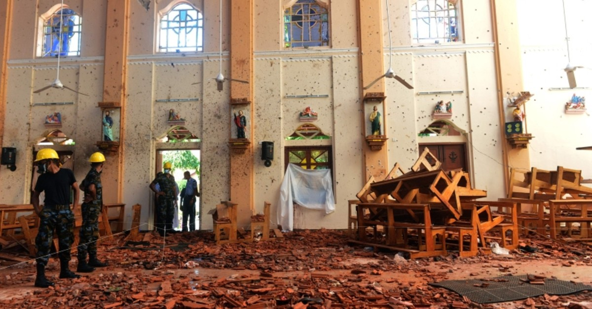 Security personnel inspect the interior of St. Sebastian's Church in Negombo on April 22, 2019, a day after the church was hit in series of bomb blasts targeting churches and luxury hotels in Sri Lanka. (AFP Photo)