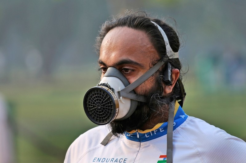 A participant wears a mask as he runs during the Delhi Half Marathon in New Delhi, India ( AP Photo)