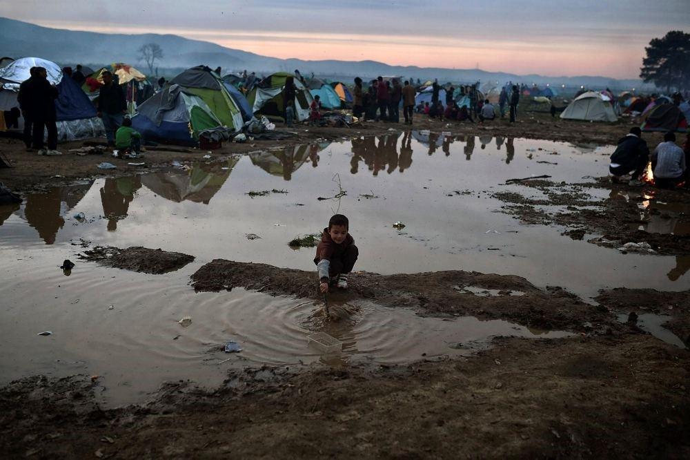 A child plays at the makeshift camp at the Greek-Macedonian borders, near the village of Idomeni.