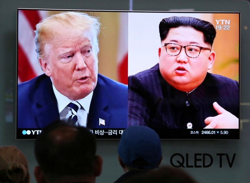 In this May 24, 2018, file photo, People watch a TV screen showing file footage of U.S. President Donald Trump, left, and North Korean leader Kim Jong Un during a news program at the Seoul Railway Station in Seoul, South Korea. (AP Photo)