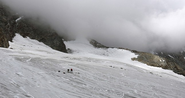 This undated  picture released by the police in canton Valais shows the place at Hohlaub Glacier near Saas Fee, Switzerland where the body of a German hiker was found. (AP Photo)