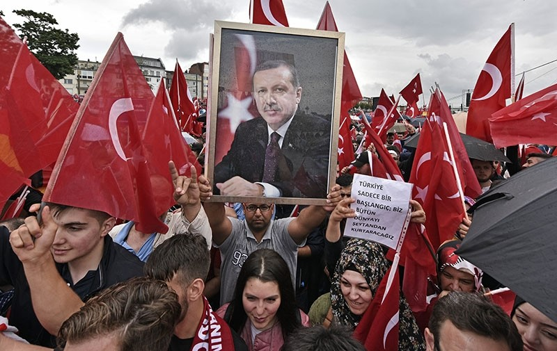 Supporters of Turkish President Recep Tayyip Erdou011fan demonstrate in Cologne amid heavy police presence. (AP Photo)